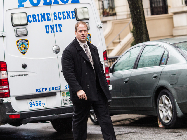 <p>An investigator outside 388 Clinton St. in Brooklyn after a woman was found with a fatal head wound on Feb. 23, 2013.</p>