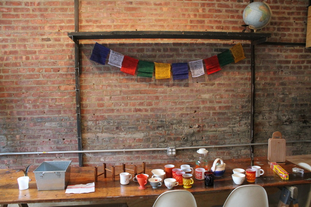 <p>Prayer flags adorn the wall of Goodies, which is still under renovation behind Good Yoga in Bed-Stuy.</p>