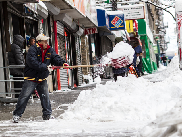 <p>A resident in Washington Heights clears snow off the sidewalk on 181st. Street, between Broadway and Fort Fort Washington Avenue, on Feb. 9, 2013.</p>