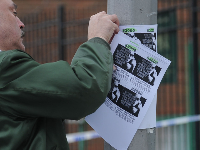 <p><span>Neighborhood volunteer Sidney Flores posts reward fliers on Eagle Avenue in The Bronx. </span></p>
