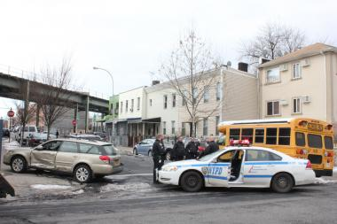 Fourteen people were injured when a school bus and another vehicle collided in Bushwick on Tuesday Feb. 12, 2013.