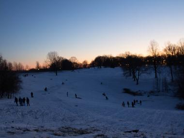 Staten Islanders sled at Silver Lake Park at sunset on Feb. 9, 2013.