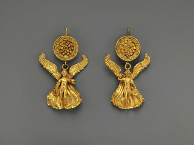 <p>These gold earrings, which date to 300 B.C., depict Eros with a disk.</p>