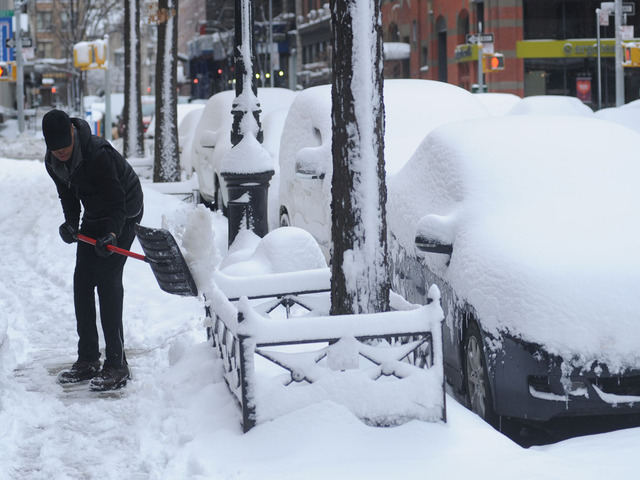 <p>A man shovels in Greenwich Village on Feb. 9, 2013.</p>