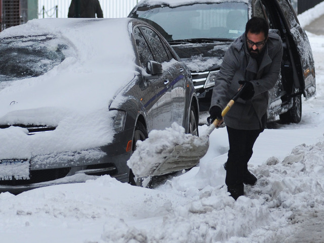<p>A man shovels his car out on Wooster Street after the snowstorm on Feb. 9, 2013.</p>