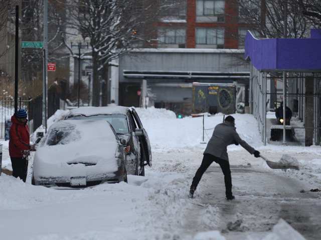 <p>People clear snow on Wooster Street after the snow storm on Feb. 9, 2013.</p>