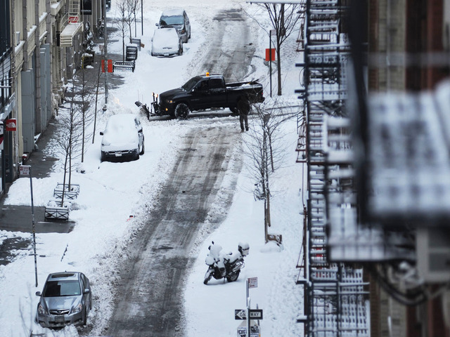 <p>A plow crosses Prince Street at Wooster Street after Winter Storm Nemo on Feb. 9, 2013.</p>