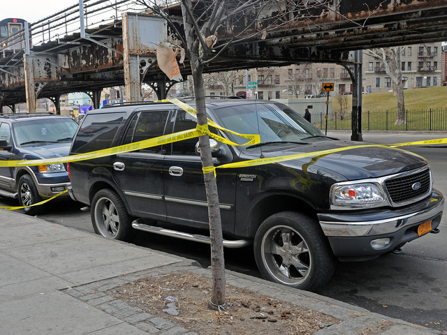 <p>An SUV behind crime tape near where a 5-year-old boy was shot in The Bronx Feb. 22, 2013.</p>