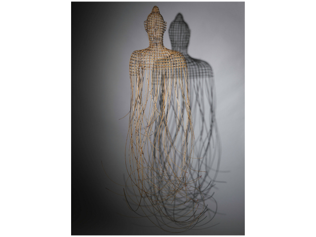 <p>The strand ends of Sopheap Pich&#39;s Buddha are red. Pich explained on a museum placard that the image stems from a childhood memory, when he entered a Buddhist temble and found blood splattered everywhere.</p>