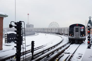A Q train leaves the snow-covered Stillwell Avenue station in Brooklyn after Winter Storm Nemo on Feb. 9, 2013.