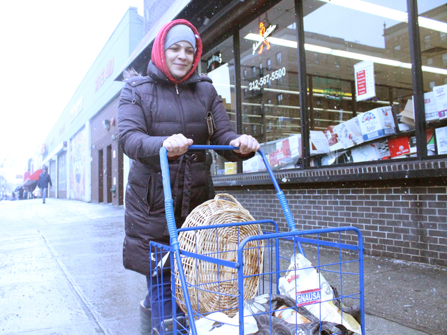 <p>Inwood resident Vanessa Martir stocked up on supplies before Winter Storm Nemo hit Friday. &quot;We weren&#39;t ready for Sandy, so I&#39;m taking pre-emptive measures,&quot; said Martir.</p>