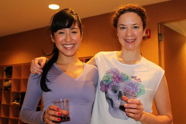 <p>Francesca Valarezo and Dana Slamp enjoy wine at Stefani Jackenthal&#39;s Pure Yoga wine tasting.&nbsp;</p>