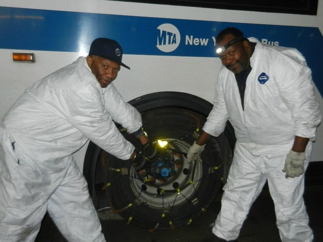 <p>Workers lashed bus tires with chains as the Metropolitan Transportation Authority prepared for Winter Storm Nemo to blast New York City on Friday Feb. 8, 2013.</p>