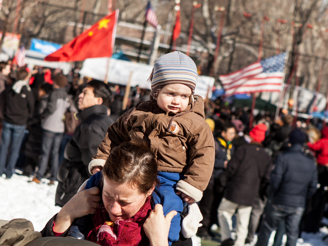 <p>A young boy enjoys the Chinese New Year celebrations in the Sara D. Roosevelt Park, New York City on Feb. 10, 2013.</p>