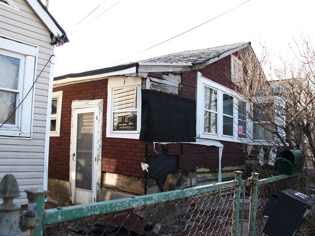 <p>Residents have complained to the city about the homes at 774 and 776 New Dorp Lane. The properties were slapped with a $500 fine in October, but it has not been paid. Residents fear the structures could topple in the next big storm, March 5, 2013.</p>