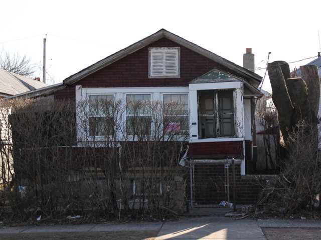 <p>Residents say they want the abandoned homes at 774 and 776 New Dorp Lane demolished, because they fear their structural integrity has worsened since Hurricane Sandy. March 5, 2013.</p>