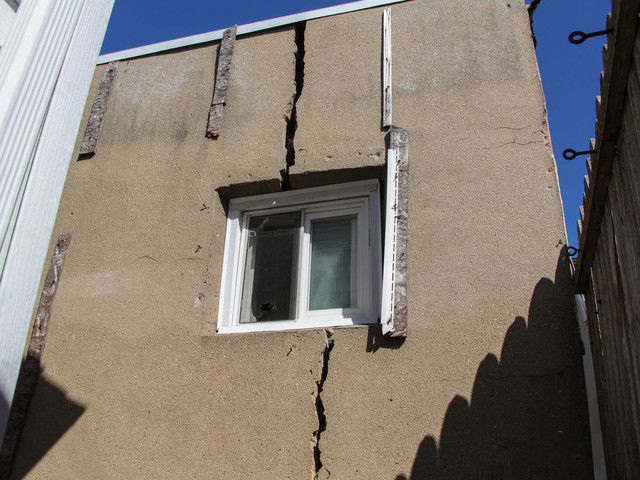 <p>The back of the home of 776 New Dorp Lane has a crack running down the concrete, which got larger after Hurricane Sandy. Neighbors fear that a storm could make the house collapse, March 5, 2013.</p>