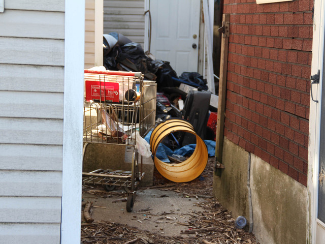 <p>The yard of 774 and 776 New Drop Lane has trash all over it. The houses have been abandoned for years and residents fear they are filled with mold and in danger of collapsing after additional Sandy damage, March 5, 2013.</p>