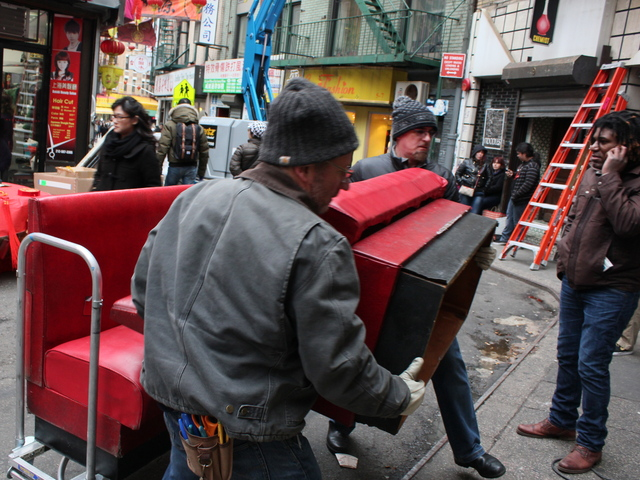 <p>Film crews move bench seats into the Nom Wah Tea Parlor ahead of filming for &quot;The Amazing Spider-Man 2.&quot;</p>