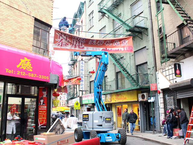 <p>Film crews string banners over Doyers Street ahead of filming for &quot;The Amazing Spider-Man 2.&quot;</p>