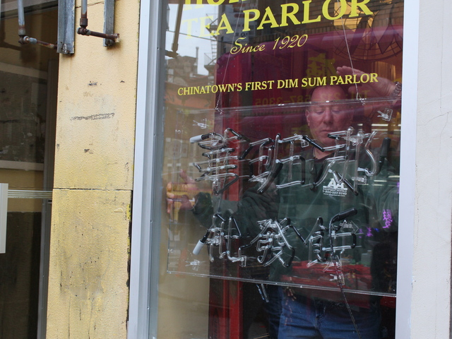 <p>A film crew member affixes a neon sign inside Nom Wah Tea Parlor ahead of filming for &quot;The Amazing Spider-Man 2.&quot;</p>