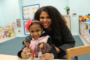Karen Braithwaite, 40, a human resources manager, with daughter Georgia, 4, is leading the charge to get Mattel to produce more products featuring Barbies of color after she couldn't find party supplies for the black Barbie-themed 5th birthday party her daughter wanted.