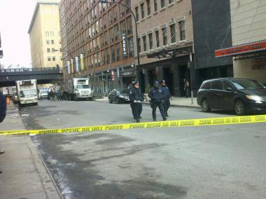 Police shut down part of West 16th Street on Tuesday March 26, 2013, to investigate a bomb scare in the area.