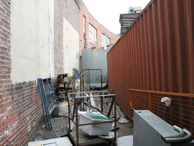 <p>The owners envision backyard tables in this area with large windows looking into the brewery filling the spaces currently sealed with cement.</p>