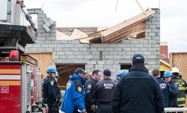 <p>Rescue workers at the scene of a building collapse on East 95th Street in Canarsie on March 22, 2013.</p>