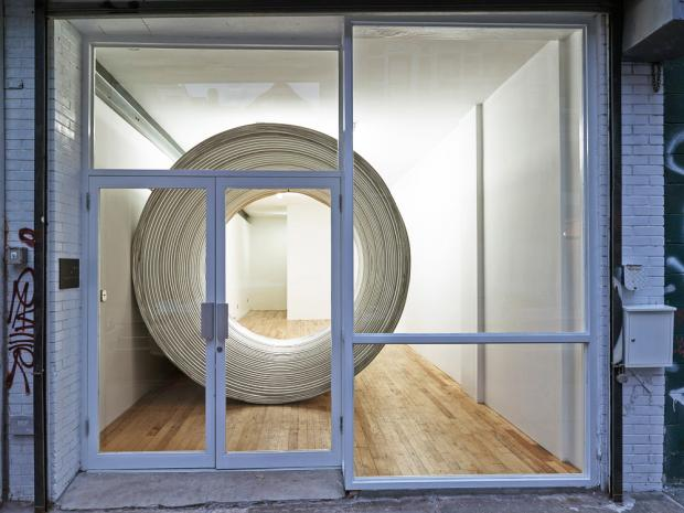 Brooklyn artist Charles Harlan created a mystery of how a 10-foot cylinder into a tiny gallery.