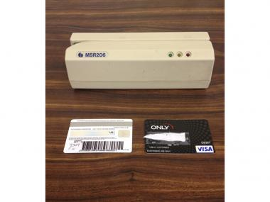 Cops recovered fraudulent credit cards, cash, and this credit card magnetic-strip encoding device from a room they searched at the Hotel Pennyslvania Thursday, March 22, 2013, the NYPD says.