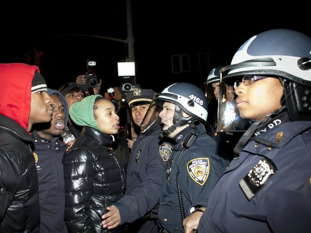 <p>Demonstrators faceoff against police during a protest against the shooting of Kimani Gray, March 13, 2013 in the East Flatbush neighborhood of the Brooklyn borough of New York City. 16-year-old Kimani Gray was shot and killed by police on March 9, provoking protests and unrest in the neighborhood.</p>