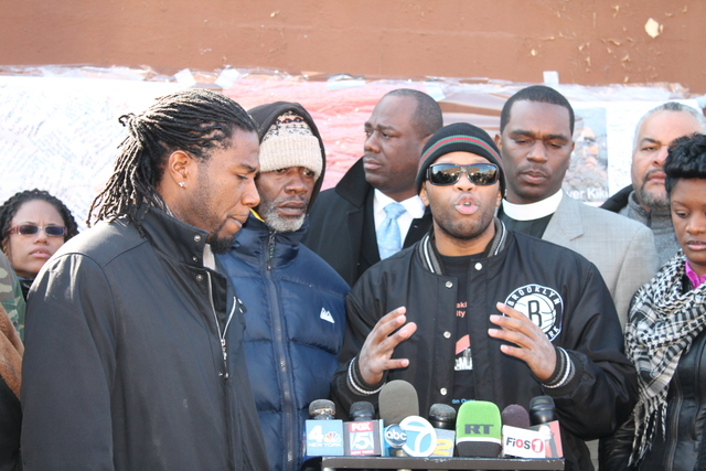 <p>Kimani Gray&#39;s father, Gerard Gray, dressed in the blue coat, made a brief appearance at the press conference.</p>