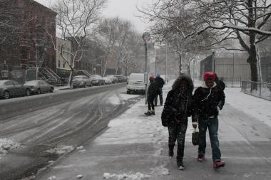 A couple walks through the snow on Franklin Avenue toward DeKalb Avenue on March 8, 2013.