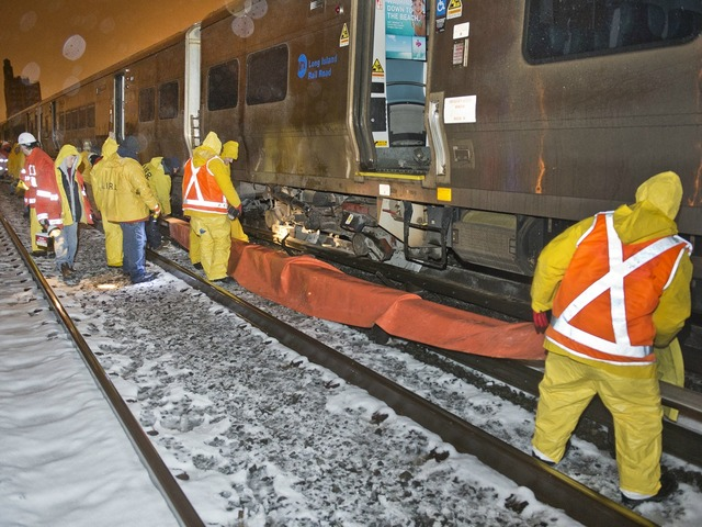 <p>Crews worked through the night to right a train that had fallen off the rails Monday March 18, 2013.</p>