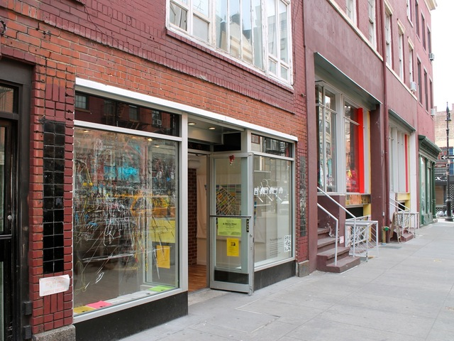 <p>The storefront is located on the south side of West Eighth Street, west of MacDougal Street.</p>