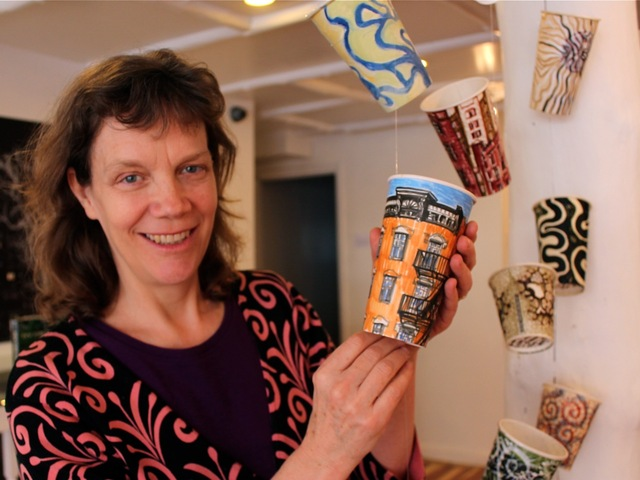 <p>Painter Gwenyth Leech sells painted coffee cups for $300 each. More than 200 of these are in display on West Eight Street through Saturday, March 23, 2013.</p>