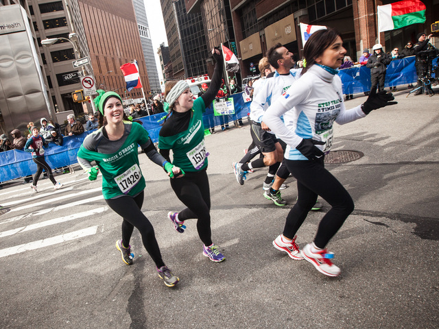 <p>A group of runners turn the final corner and head for the finish line at the annual NYC Half marathon on Mar. 17, 2013.</p>