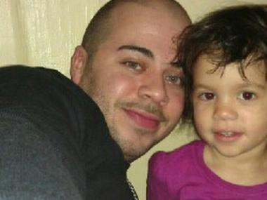 Hailey Martinez, 3, was in criticial but stable condition March 18, 2013, one day after a fire in her Bronx home killed her 7-year-old sister. Hailey is shown with her father, Shaun Martinez.