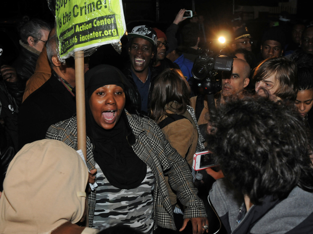 <p>Activists and community members protest in front of the 67th Precinct on Flatbush Avenue against the police-involved shooting of 16-year-old Kimani Gray, March 12, 2013.</p>