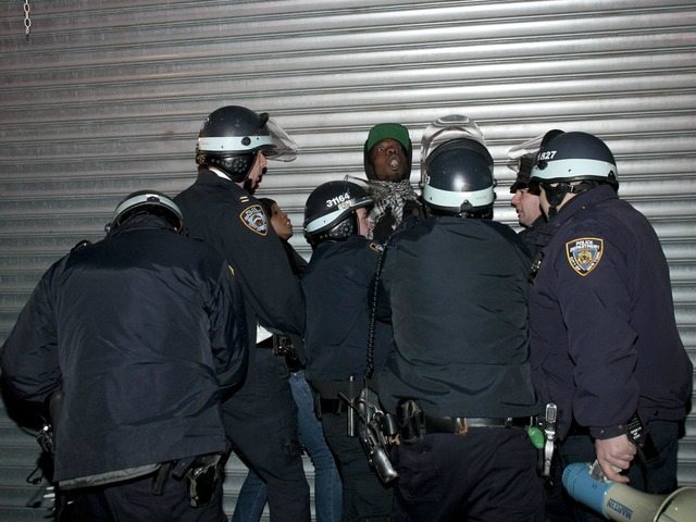 <p>A man is arrested during a protest against the shooting of Kimani Gray, March 13, 2013 in the East Flatbush neighborhood of the Brooklyn borough of New York City. 16-year-old Kimani Gray was shot and killed by police on March 9, provoking protests and unrest in the neighborhood.</p>