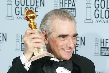 "Director Martin Scorsese poses with his award for Best Director for ""Gangs of New York"" backstage during the 60th Annual Golden Globe Awards."