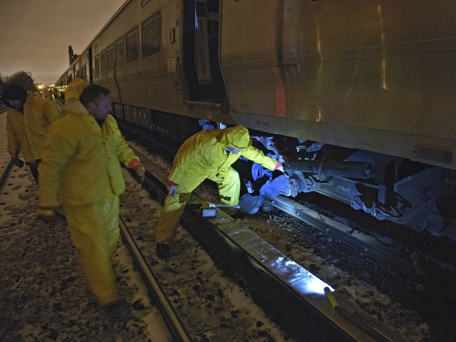 <p>Crews worked through Monday night and into Tuesday after a train derailed and damaged track, but it was unclear when they would be finished.</p>