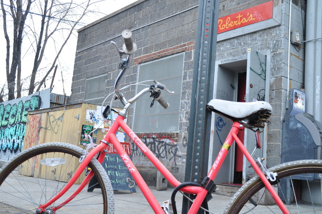 <p>A customer&#39;s bike was locked to a pole outside Roberta&#39;s Pizza Friday. The restaurant hopes to install four bike corrals on Moore Street this spring.</p>