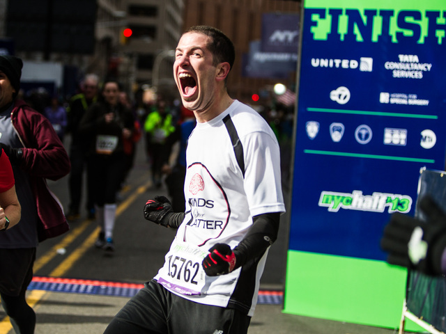 <p>A runner celebrates after crossing the finish line of the 8th Annual NYC Half marathon at the South Street Seaport Mar. 17th, 2013.</p>