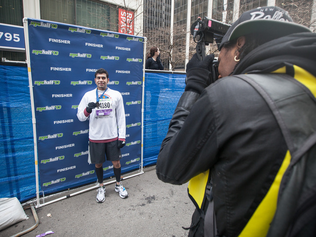 <p>A runner is photographed after successfully completing the annual NYC Half marathon on Mar. 17, 2013.</p>