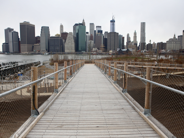 <p>Squibb Bridge provides sweeping views of the Lower Manhattan skyline.</p>
