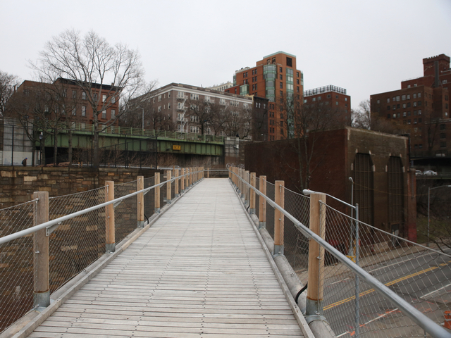 <p>Squibb Bridge angles up to the Brooklyn Heights Promenade.</p>