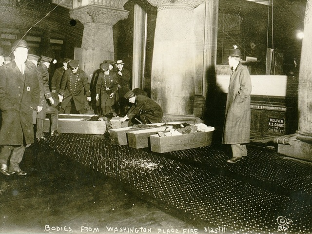 <p>A March 25, 1911, photo shows officials placing Triangle Shirtwaist Company fire victims into caskets.&nbsp;</p>