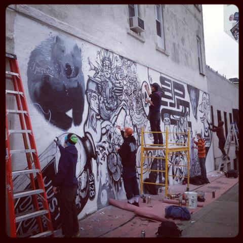 <p>Artists from &quot;En Masse&quot; mural project painted the wall of Tutu&#39;s in Bushwick.</p>